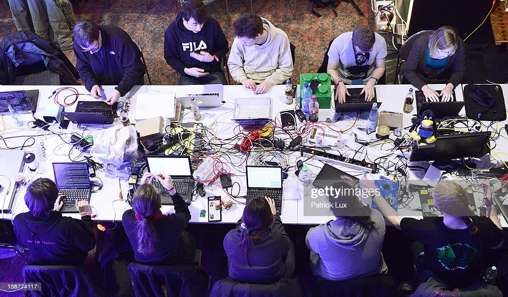 Participants work at their laptops at the annual Chaos Computer Club (CCC) computer hackers' congress, called 29C3, on December 28, 2012 in Hamburg, Germany. The 29th Chaos Communication Congress (29C3) attracts hundreds of participants worldwide annually to engage in workshops and lectures discussing the role of technology in society and its future.