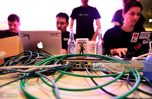 Participants work at their their laptops at the annual Chaos Computer Club computer hackers' congress called 29C3 on December 28 2012 in Hamburg...