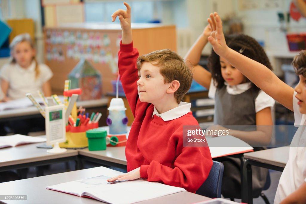 Teilnahme an seiner elementaren Klasse : Stock-Foto