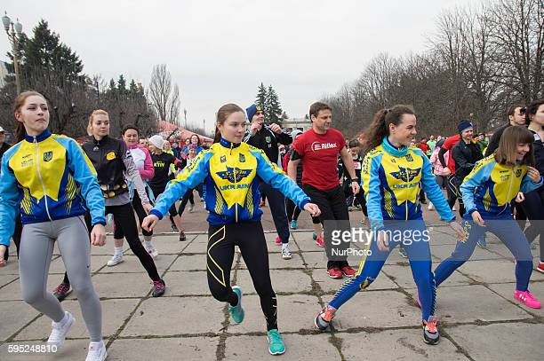 Participating runners seen warming up before the run Hundreds of Ukrainian runners took for in a running event to raise awareness of the Crimea issue...