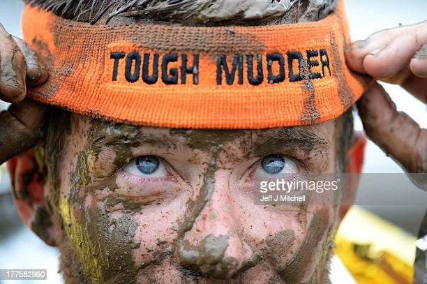 Participents take part in the Tough Mudder endurance event at Dalkieth Country Estate on August 24 2013 in Edinburgh Scotland The worldfamous Tough...