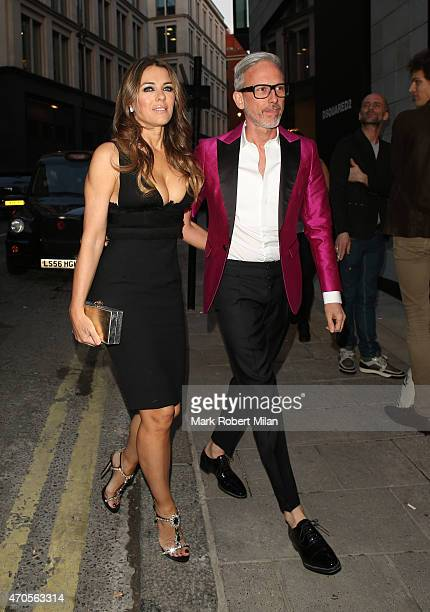 Partick Cox and Elizabeth Hurley attending the Dsquared2 store opening on April 21 2015 in London England
