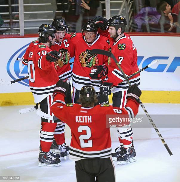 Partick Sharp Jonathan Toews Marian Hossa Brent Seabrook and Duncan Keith of the Chicago Blackhawks celebrate Toews second period goal against the...