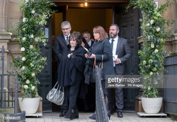 Partick Thistle chairwoman Jacqui Low leads the mourners after the funeral service of EuroMllions winner Colin Weir at Partick Burgh Hall Glasgow