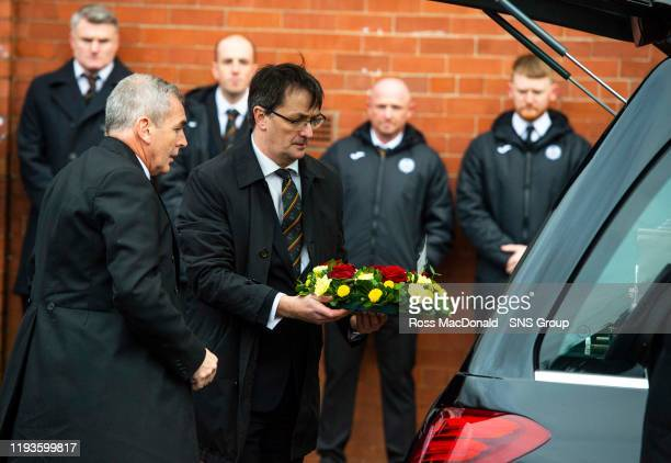 Partick Thistle Chief Executive Gerry Britton lays a wreath in tribute to Partick Thistles majority shareholder Colin Weir at The Energy Check...