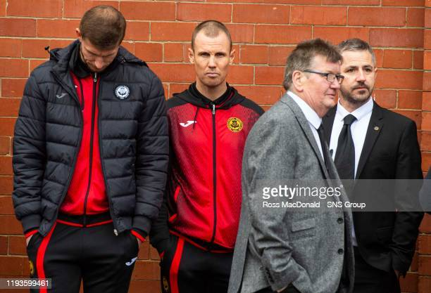 Partick Thistles Kenny Miller gather to pay tribute to Partick Thistles majority shareholder Colin Weir at The Energy Check Stadium at Firhill on...