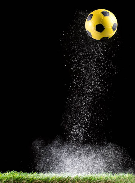 Particles of powder for the impact Ball of football in the lawn  of a soccer field
