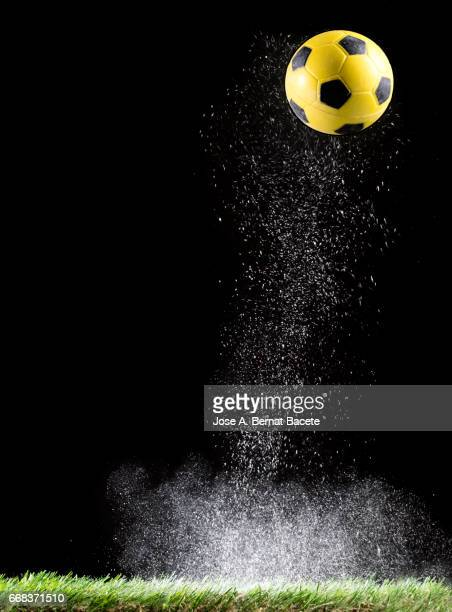 particles of powder for the impact ball of football in the lawn  of a soccer field - inspiración stock pictures, royalty-free photos & images