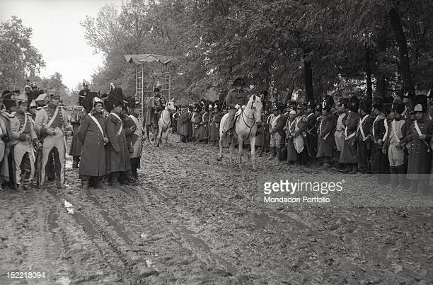 A particular during filming of King Vidor's 'War and Peace' a crowd of extras as French soldiers and officials during the passing of Napoleon...
