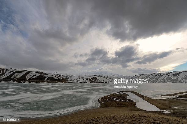 Particularly melted ice floes are seen over Zernek Dam Lake as the weather temperatures are rising above 0 Celcius degree in Gurpinar District of...