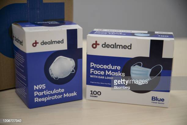N95 particulate respirator masks and procedure face masks are arranged for a photograph at a DealmedPark Surgical supply facility in Lakewood New...