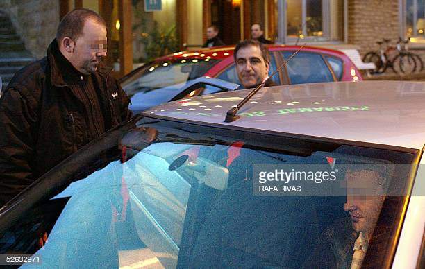 Partido Popular candidate for the 17 April 2005 Basque regional elections Leopoldo Barreda goes into his car next to his two bodyguards 13 April 2005...