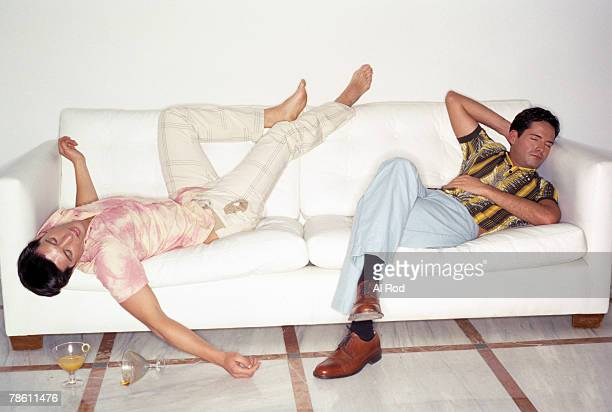 partiers passed out on sofa - passed out drunk stock photos and pictures