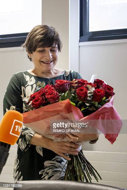 Partij van de Arbeid party leader Lilianne Ploumen holds a bouquet of roses at the Binnenhof, the day after the House of Representatives elections in...