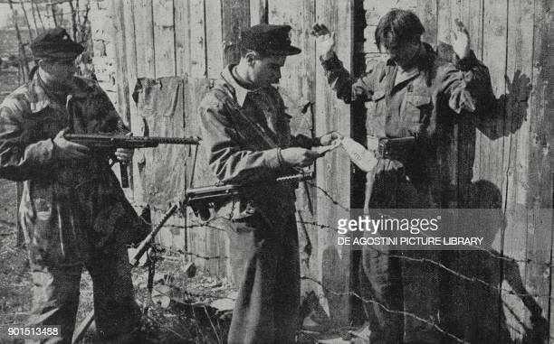 Partisan captured by the National Republican Guard in Slovenia World War II photograph by Luce Mantovan from L'Illustrazione Italiana Year LXXI No 40...