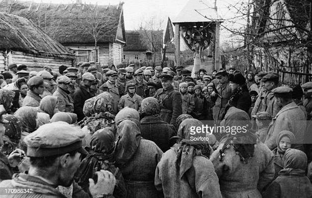 Partisans holding a meeting devoted to the 26th anniversary of the october revolution in a village in western byelorussia, world war 2.