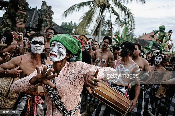 Partisipants dance during the Ogoh-ogohs parade on March 11, 2013 in Tunjuk Village, Tabanan, Bali, Indonesia. For the Balinese, Ogoh-ogohs reflect...