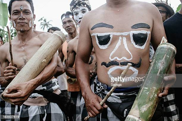Partisipants paint their face and body during Ogoh-ogohs parade on March 11, 2013 in Tunjuk Village, Tabanan, Bali, Indonesia. For the Balinese,...