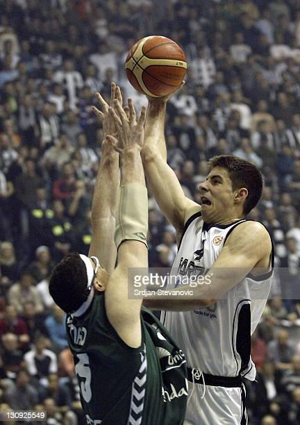 Partizan Belgrade player Milenko Tepic right try to score over Daniel Santiago left from Unicaja Malaga during a group B Euroleague basketball match...