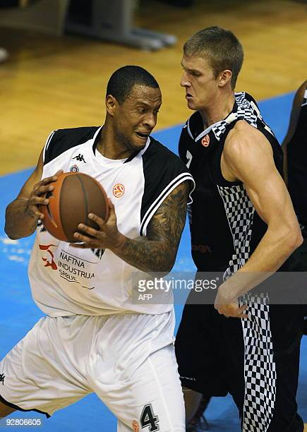 Partizan Belgrade's Lawrence Roberts vies with Entente Orleanaise's Justin Doellman during their Euroleague group B basketball match on November 5...