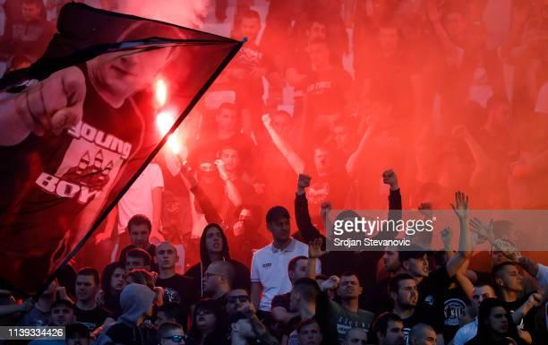 Partizan fans light torches during the Super League match between FK Crvena Zvezda and FK Partizan at stadium Rajko Mitic on April 25, 2019 in...