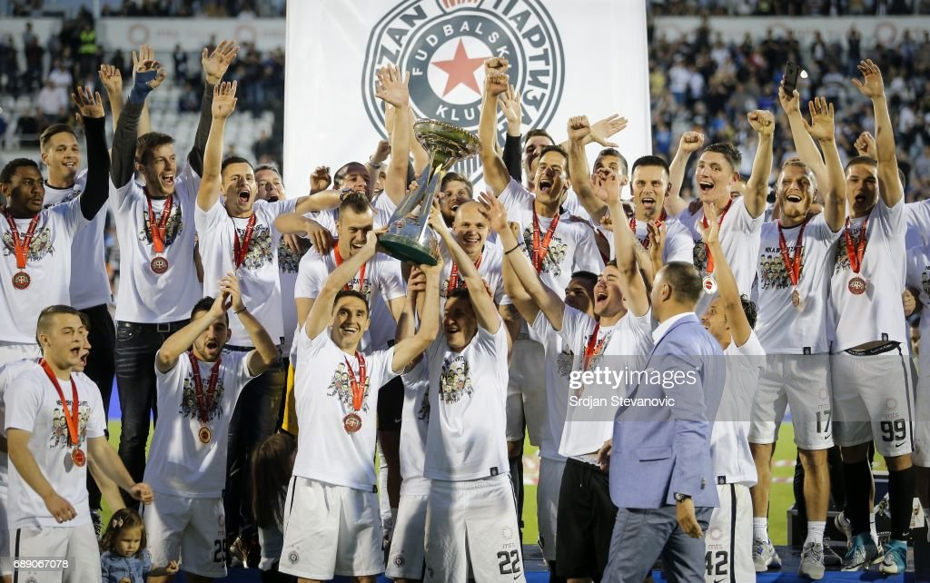 Partizan players celebrate after winning Serbia's national Cup final between Fc Partizan and Fc Crvena Zvezda on May 27, 2017 in Belgrade, Serbia.