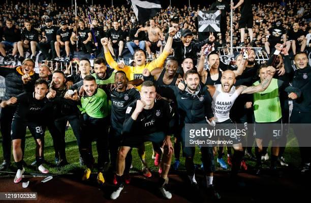 Partizan players celebrate after winning the Serbian Cup Semi Final match between FK Partizan and FK Crvena Zvezda on June 10, 2020 in Belgrade,...