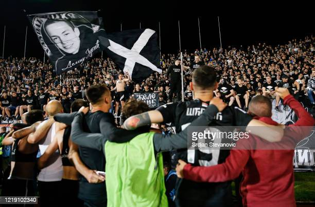 Partizan players celebrate with fans after winning the Serbian Cup Semi Final match between FK Partizan and FK Crvena Zvezda on June 10, 2020 in...