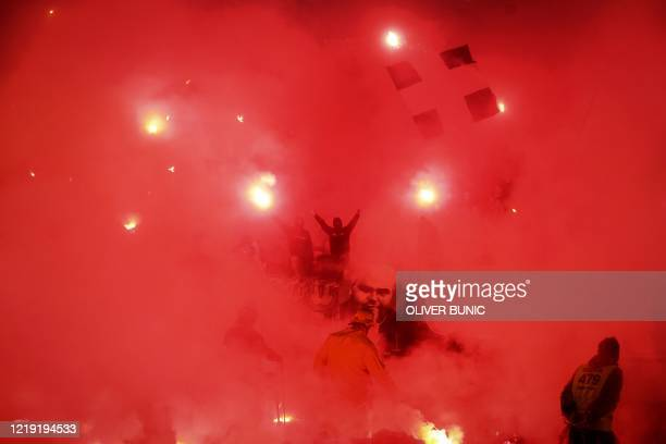Partizan supporters cheer and light flares during the Serbian Cup semi-final football match between FK Partizan Belgrade and Red Star Belgrade at the...