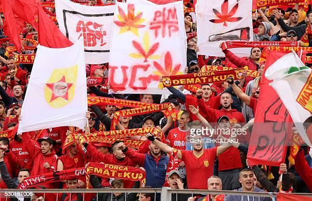 "Partizanis fans cheer during the match between KF Tirana and FK Partizani at ""Selman Stermasi"" stadium in Tirana on May 4, 2016. / AFP / GENT..."