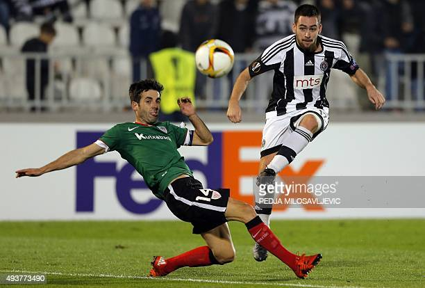 Partizan's Andrija Zivkovic kicks the ball in front of Athletic's Markel Susaeta during the UEFA Europa League Group L football match between...