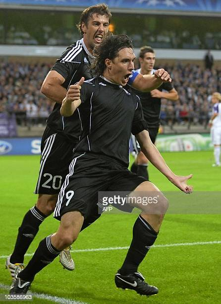 Partizan's Cleo Gabrijel Cordova Cleverson and Partizan's Mladen Krstajic celebrate after Cleverson scored the first goal during the UEFA Champions...