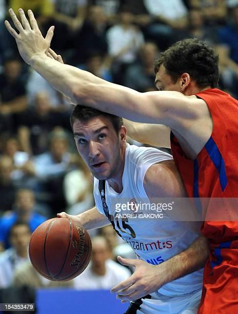 Partizan's Dejan Musli vies with CSKA Moscow's Sasha Kaun during the Euroleague group D match between Partizan mt:s Belgrade and CSKA Moscow at...