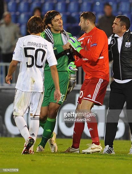 Partizan's goalkeeper Vladimir Stojkovic argues with Neftchi's goalkeeper Sasa Stamenkovic during the UEFA Europa League group H football match...