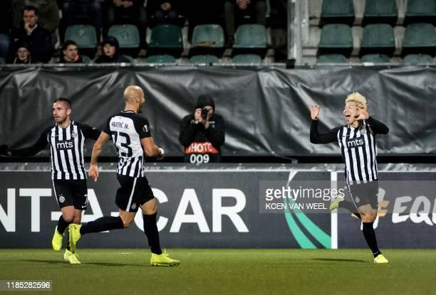 Partizan's Japanese forward Takuma Asano celebrates after scoring a goal during the UEFA Europa League Group L football match between AZ Alkmaar and...