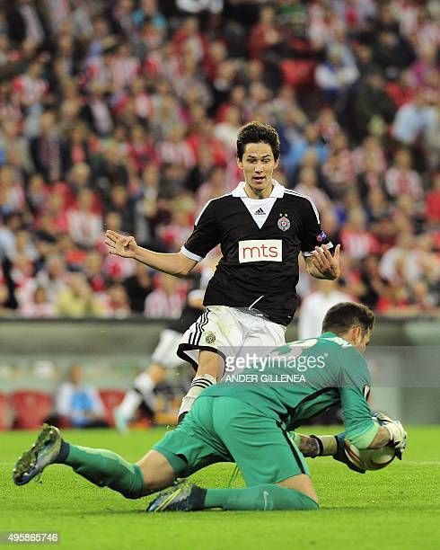 Partizan's midfielder Sasa Lukic vies with Athletic Bilbao's goalkeeper Iago Herrerin during the UEFA Europa League group L football match Athletic...