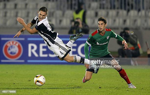 Partizan's Miroslav Vulicevic vies with Athletic's Sabin Merino during the UEFA Europa League Group L football match between Partizan and Athletic...