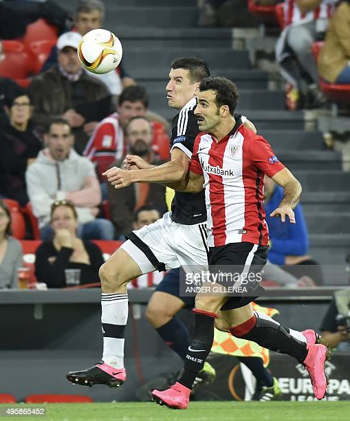 Partizan's Montenegrin midfielder Petar Grbic vies with Athletic Bilbao's defender Mikel Balenziaga during the UEFA Europa League group L football...