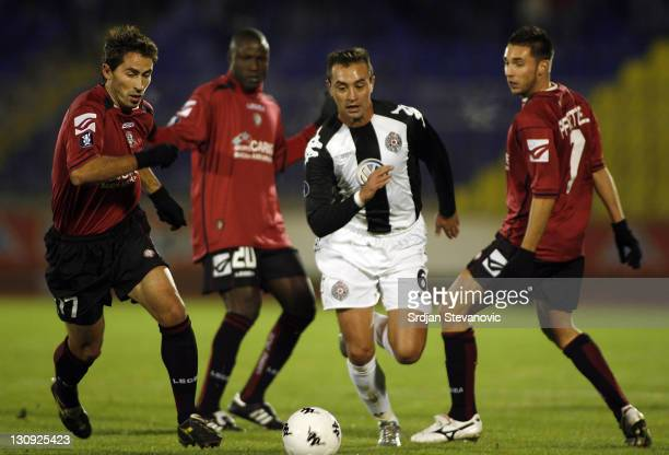 Partizan's player Zajic Bojan center control the ball between Grandoni Alessandro left Pfertzel Mare left of Livorno during a Uefa Cup Group A match...