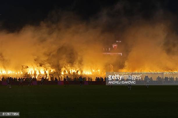 Partizan's supporters burn smoke grenades during the Serbian National soccer league derby match between Partizan and Red Star, in Belgrade on...