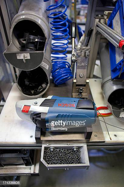 A partly assembled Bosch electric angle grinder waits on the assembly line at the professional power tools division of Robert Bosch GmbH in...