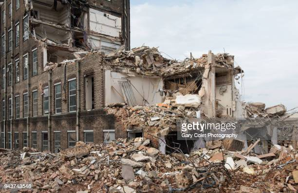partly demolished large building - demolishing stock pictures, royalty-free photos & images