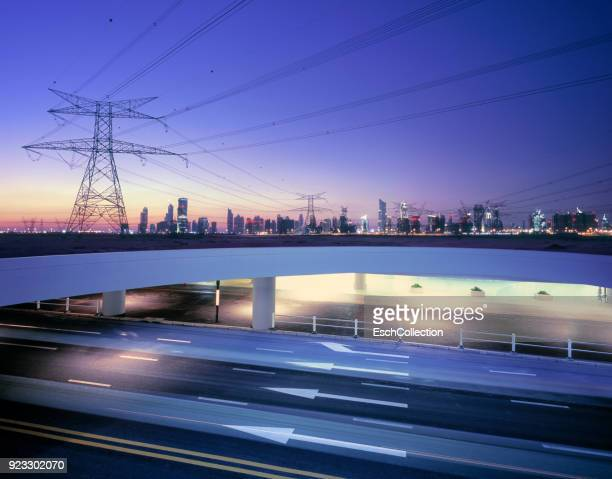 Partly underground ring road and power lines serving large city