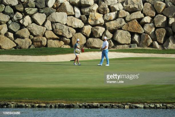 Partner and caddie Helen Storey celebrates with Lee Westwood of England on the 12th green during Day Three of the Abu Dhabi HSBC Golf Championship at...