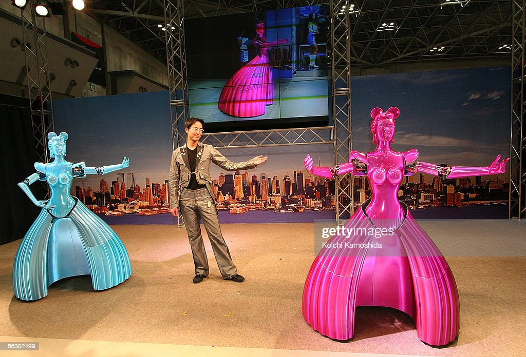 Partner Ballroom Dance Robots (PBDR) of robotic venture Nomura Unison dances with a man during 2005 International Robot Exhibition on November 30, 2005 in Tokyo, Japan.
