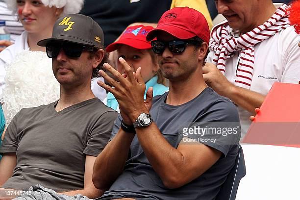 Partner of Ana Ivanovic of Serbia Australian professional golfer Adam Scott watches the third round match between Ivanovic and Vania King of the...