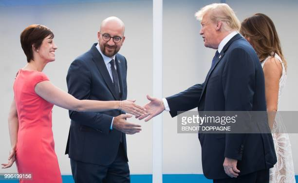 Partner of Michel Amelie Derbaudrenghien and Belgian Prime Minister Charles Michel welcome US President Donald Trump and First Lady of the US Melania...