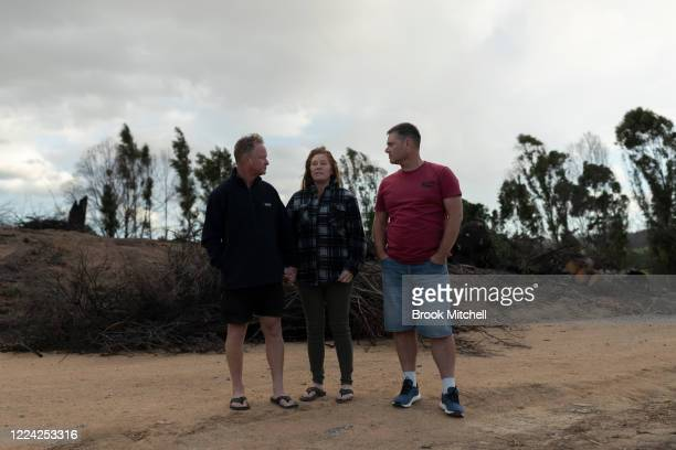 Partners and bushfire survivors Marylin Mills and Mick Thompson along with paramedic Craig Howker are pictured on Mick and Marylin's Cobargo property...