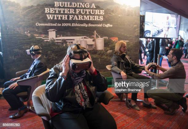 Partners and shareholders including Lisa Haeg of Puyallup Washington takes part in a virtual reality tour of the Starbucks Costa Rica coffee farm...