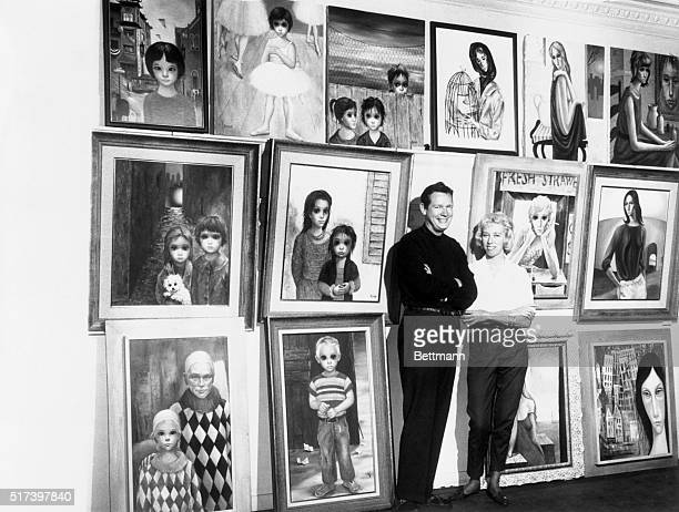 Partners in art as well as matrimony Margaret and Walter Keane show off the paintings they'll take from their native San Francisco Calif to Japan...